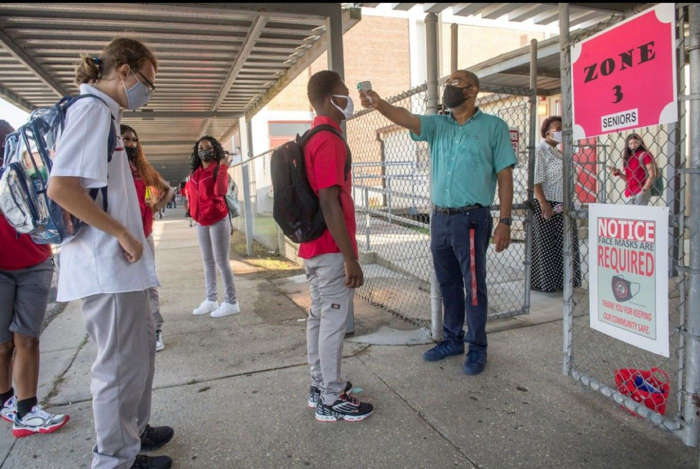 High school students getting their temperature checked before entering their school in Harvey, La., on Monday.