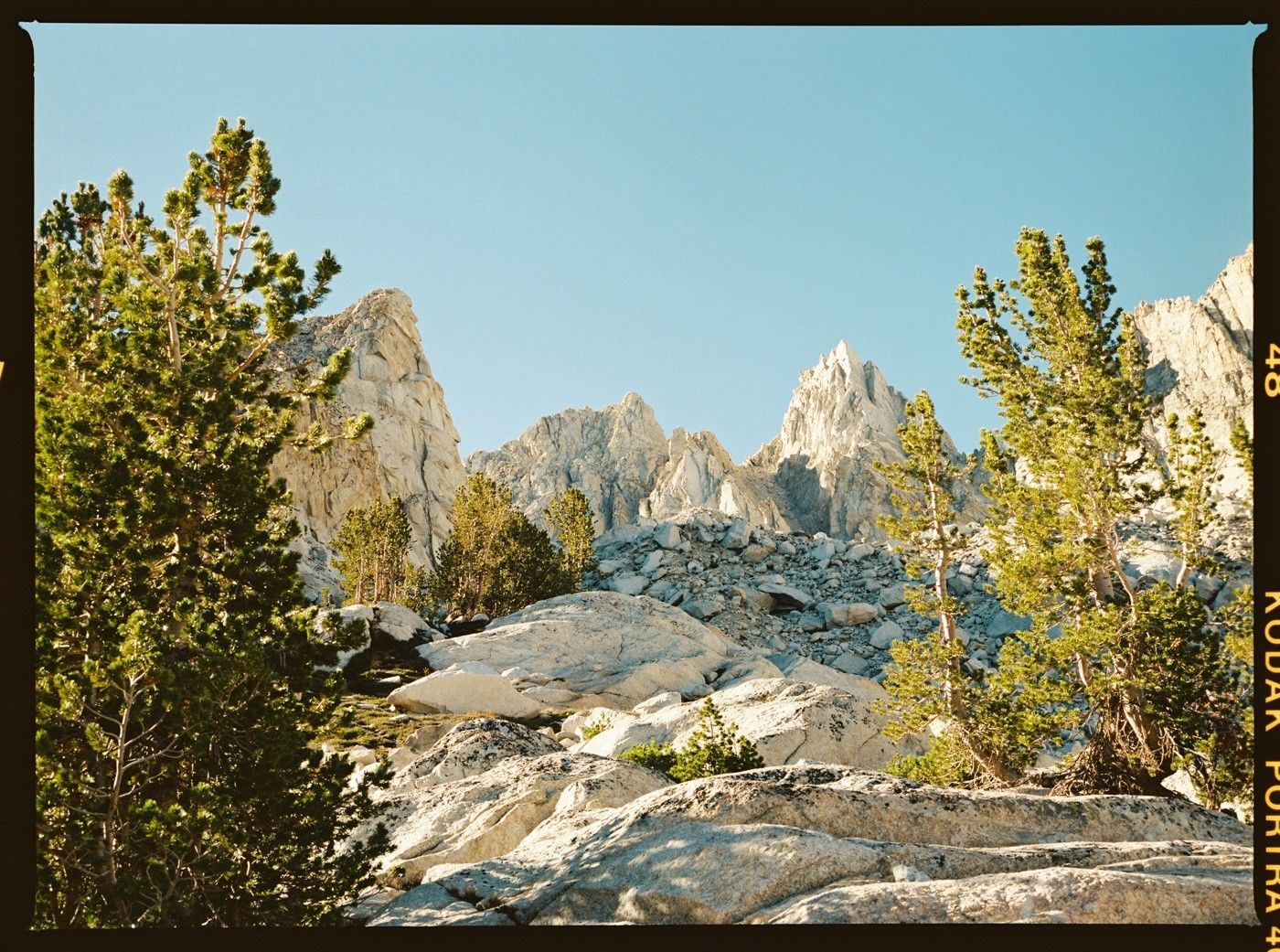 FRAME 11 — Backcountry time! Nothing like high alpine scenes. I loved the way the trees framed the towering peaks.