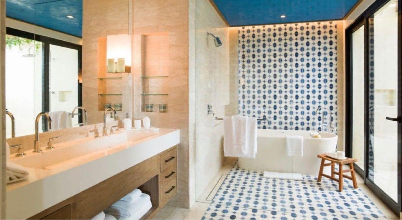 Each room has a beautiful bathroom with bath tub, indoor + outdoor shower.
